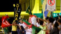 Supporters of Brazil's President Dilma Rousseff take part in a demonstration calling against her impeachment, alongside demonstrators calling for her impeachment in Brasilia, Brazil, 10th May 2016.