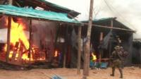 Authorities destroying a mining camp