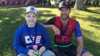 Owen sprinted across the finish line at the race in Muncie, Indiana with the help of a local athlete.