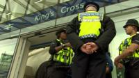 Three British Transport Police officers outside King's Cross station in London