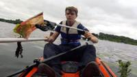 Will Darling collecting litter in his kayak