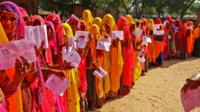Women queue up to cast their ballot in India