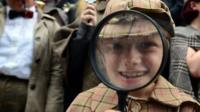 Sherlock Holmes enthusiasts with magnifying glass