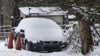 Car covered in snow near near Newby Head in North Yorkshire
