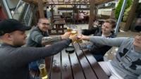 Men drinking in beer garden