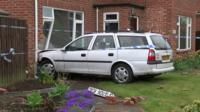 Car embedded in front of house, Trimley St Mary
