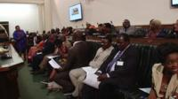 Members of the Zimbabwean parliament heckling President Mugabe during his state of the nation address