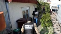 Police at house of suspected gunman in Paris suburb of Chelles