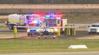 Picture of the aircraft and emergency vehicles