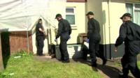 Police walk into bungalow of paedophile couple