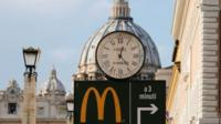 A McDonald's fast food restaurant, newly opened near the Vatican, divides opinion.