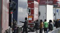 Migrants attempting to enter lorries near the port of Calais