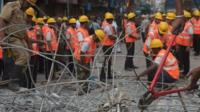 Workers at collapsed flyover site