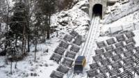 Funicular on snowy mountain