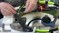 Jackie Vaughan strings a racquet