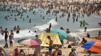 Hundreds of people on Bondi Beach in the middle of the January 2019 heatwave in Australia