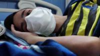 A boy in hospital in Venezuela