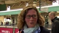 Woman leaving train station