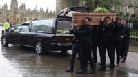 Jack Merritt's coffin being carried into church