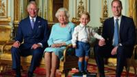 Prince George stands on foam blocks during a Royal Mail photo shoot for a stamp sheet to mark the Queen's 90th birthday. The sheet also features - Prince Charles, the Queen and Prince William