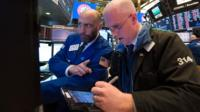 Traders talking on the New York Stock Exchange trading floor