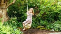 Princess Charlotte on a swing at the Chelsea Flower Show