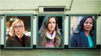 Women on posters in a subway