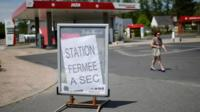 "A sign reads ""Station closed, dried up"" at a petrol station in Savenay, France, 25 May 2016"
