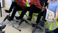 Pupils using pedal machines while reading