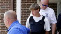 Dylann Roof centre) escorted from Shelby police station