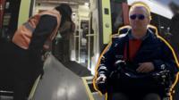 Man in wheelchair next to train.