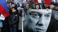Russians take part in a memorial march for Boris Nemtsov