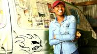 Tsarah Arts next to one of her matatus