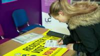 Woman registering to vote