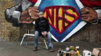 Artist Lionel Stanhope infront of finished mural