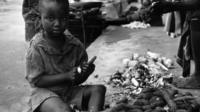 Biafran child with some yams