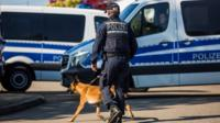Police officer with a dog in Rotttenburg am Neckar, Germany, following the arrest of a man over the Dortmund bus bombing (21 April)