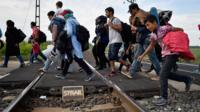 Migrants try to cross from Hungary to Austria in September 2015