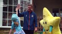 England bowler Stuart Broad high fives a young cricketer