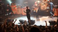 Eagles of Death Metal perform on stage on 13 November 2015 at the Bataclan concert hall in Paris