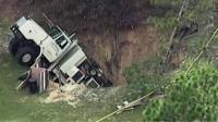 Sinkhole swallows truck