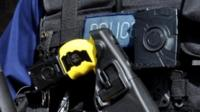 Detail of Met police handout of police officer with a Tasrer