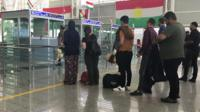 People queuing in airport