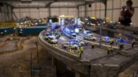 Art display show miniature model of collapsed flyover and emergency services