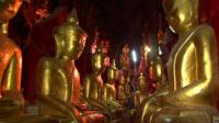 Statues of Buddha line the wall of Pindaya Cave