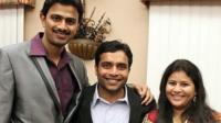 Srinivas Kuchibhotla, left, poses for photo with Alok Madasani and his wife Sunayana Dumala in Cedar Rapids, Iowa.