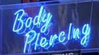 Body piercing sign