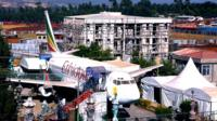 Ethiopian airlines passenger plane in the middle of a town