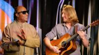 Stevie Wonder and Grayson Erhard on stage