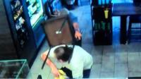 Customer hits robber with a chair